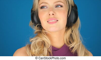 Beautiful young woman enjoying her music