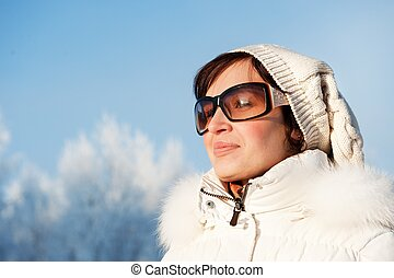 Beautiful young woman enjoying winter day