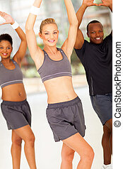 young woman exercising with friends