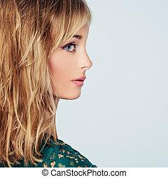 Beautiful young woman face, closeup portrait. Profile