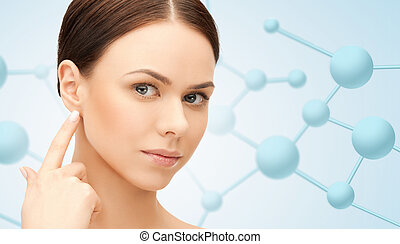 beautiful young woman face with molecules