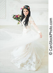 Beautiful Young Woman Fiancee in White Dress. Bride in Motion