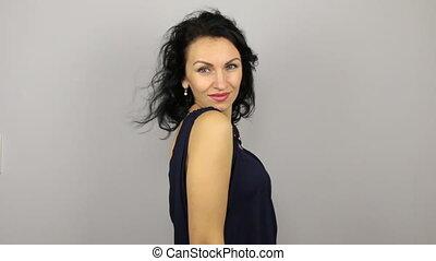 Beautiful young woman flirting and posing at the camera
