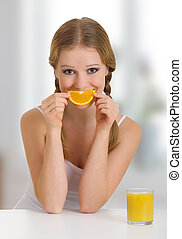 beautiful young woman full of life with orange juice