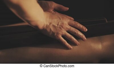 Beautiful young woman gets a relaxing massage.