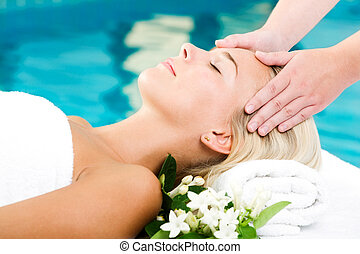 Beautiful young woman getting a spa treatment - Bright...