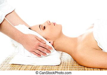 Beautiful young woman getting head massage