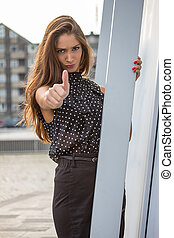 beautiful young woman giving thumps up