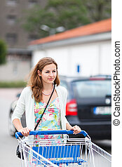 Beautiful young woman going shopping for groceries