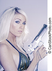 Beautiful young woman gun