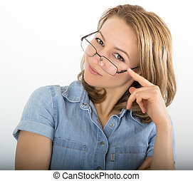beautiful young woman has many different emotions from happiness, sadness to anger and stress. She is wearing a denim shirt and glasses