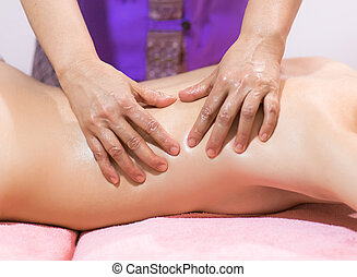 young woman having back massage close up