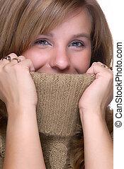 Hiding - Beautiful Young Woman Hiding Inside A Turtle Neck...
