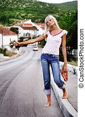 Beautiful young woman hippie posing over picturesque...