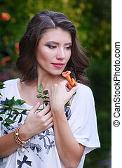 beautiful young woman holding a flower