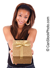 Beautiful young woman holding a gift, isolated on white