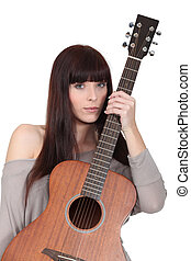 beautiful young woman holding a guitar