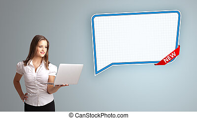 Beautiful young woman holding a laptop and presenting modern speech bubble copy space
