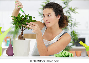 beautiful young woman holding a pot