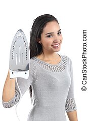 Beautiful young woman holding a smoothing iron