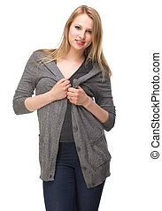 Beautiful young woman holding cardigan