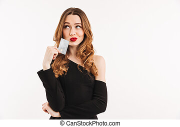Beautiful young woman holding credit card.