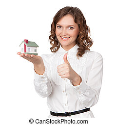 Beautiful young woman holding house model