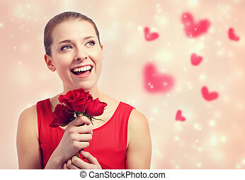 Beautiful young woman holding red roses