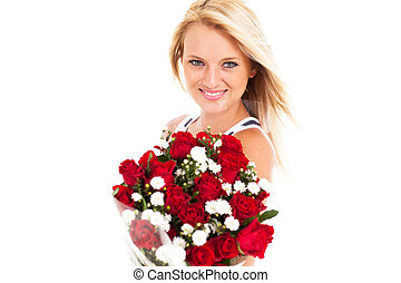 beautiful young woman holding roses