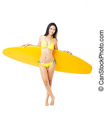 beautiful young Woman  holding surfboard