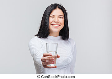 Beautiful young woman holding water glass