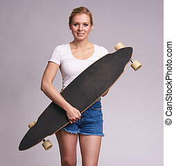 Beautiful young woman holds her longboard - Beautiful young...