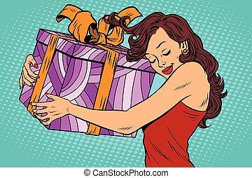Beautiful young woman hugging gift box