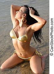 Beautiful young woman in a bikini.