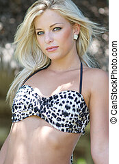 Beautiful young woman in a bikini top.