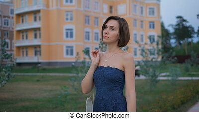 Beautiful young woman in a blue dress