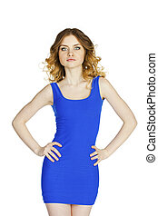 Beautiful young  woman in a blue dress posing on a white background