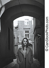Beautiful young woman in a coat