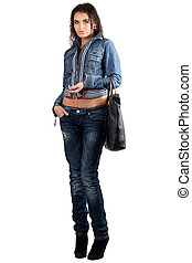 Beautiful young woman in a denim suit