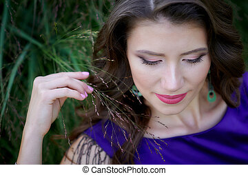beautiful young woman in a lilac dress