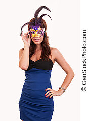 Beautiful young woman in a purple carnival mask, masquerade