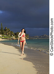 beautiful young woman in a red bikini