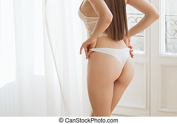 Beautiful young woman in a sexy white underwear