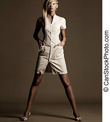 Beautiful young woman in a vogue style pose