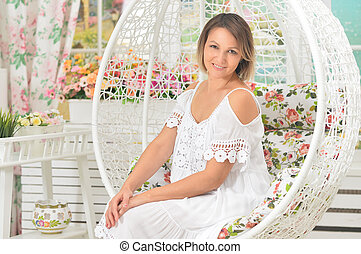 Beautiful young woman in a white dress