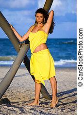 Beautiful young woman in a yellow dress