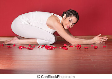 Beautiful young woman in a yoga pose
