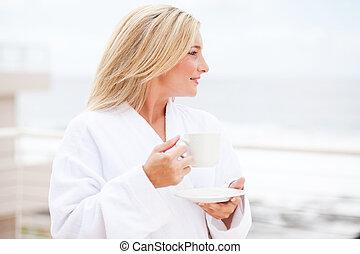 young woman in bathrobe drinking coffee - beautiful young ...