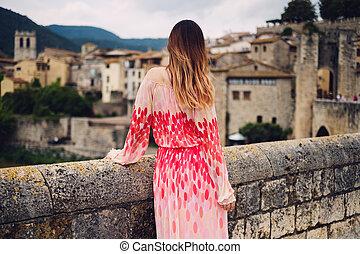 Beautiful young woman in Besalu, Spain