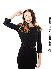 Beautiful young woman in black dress on white background
